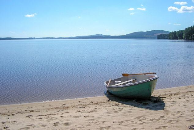 Rowing boat on a deserted beach in Ahveninen